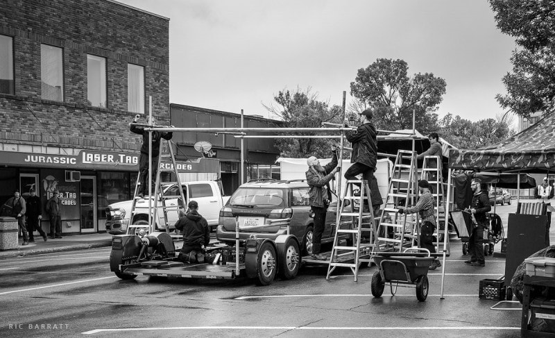 Movie production team assemble rig on trailer for car shoot.