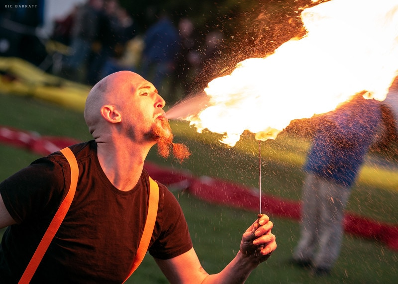 Fire breather spits out huge ball of fire.