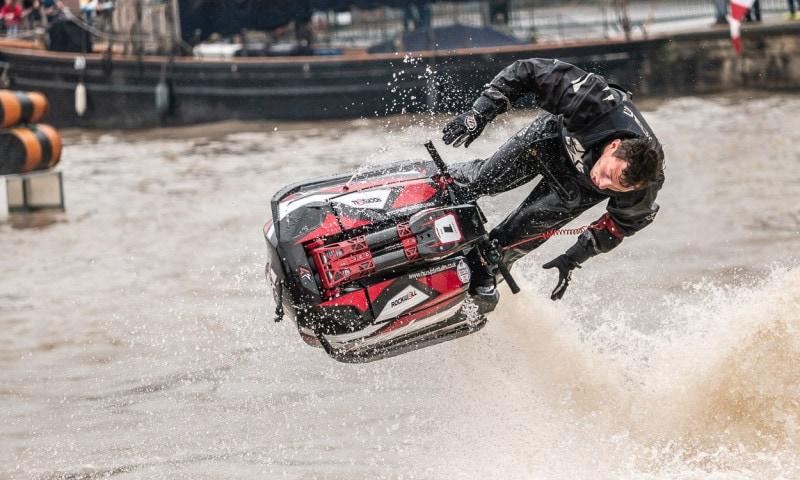 Jet-ski ride performs exhilarating jump.