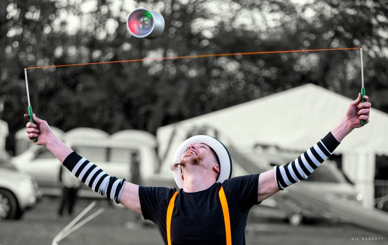 Circus artist performs with off-string yoyo.