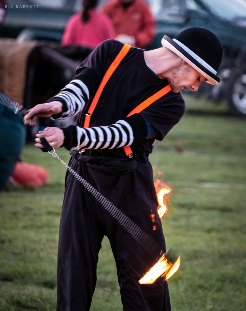 Circus performer accidentally catches trousers with fire during performance.