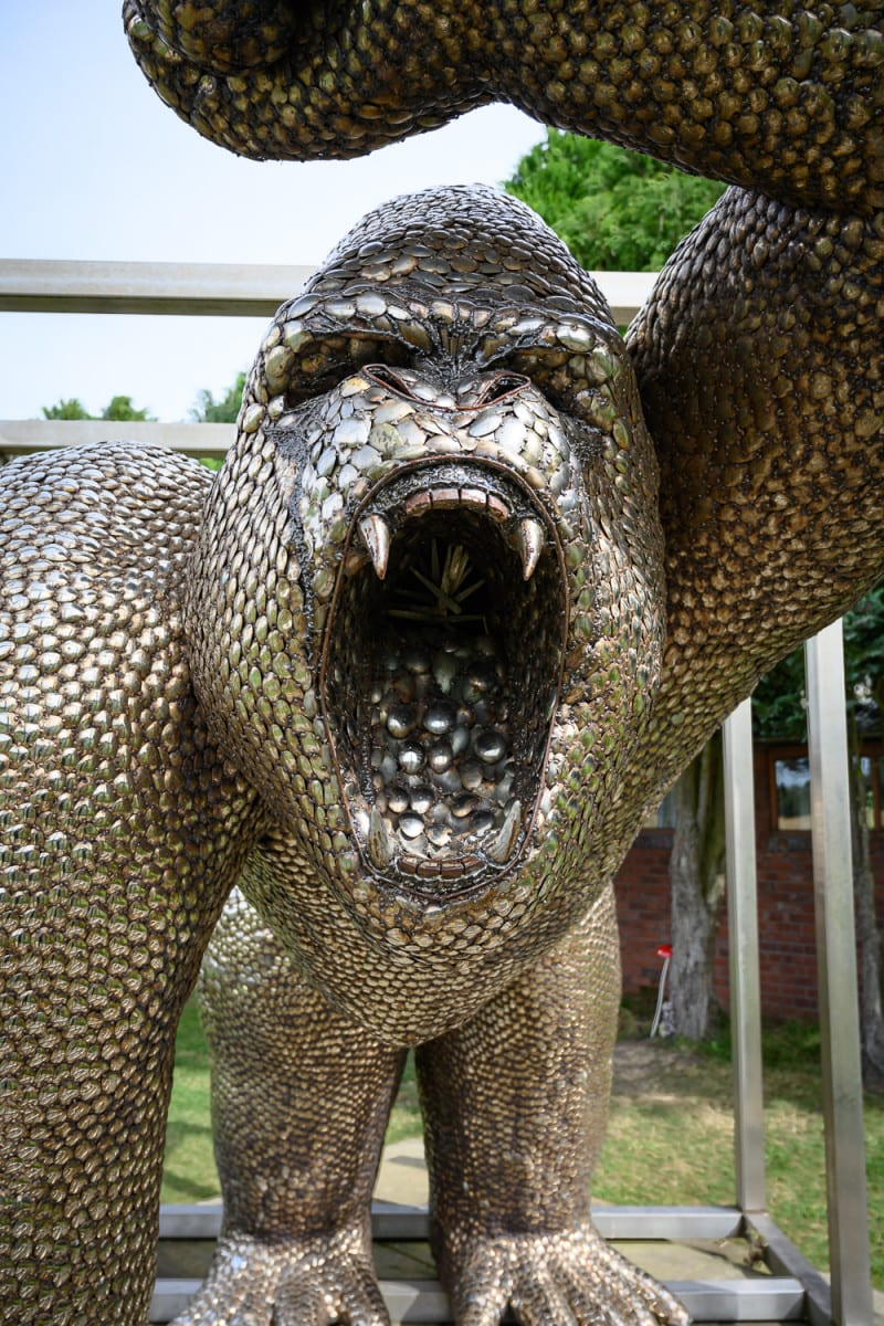 Angry gorilla sculpture made from thousands of metal spoons.