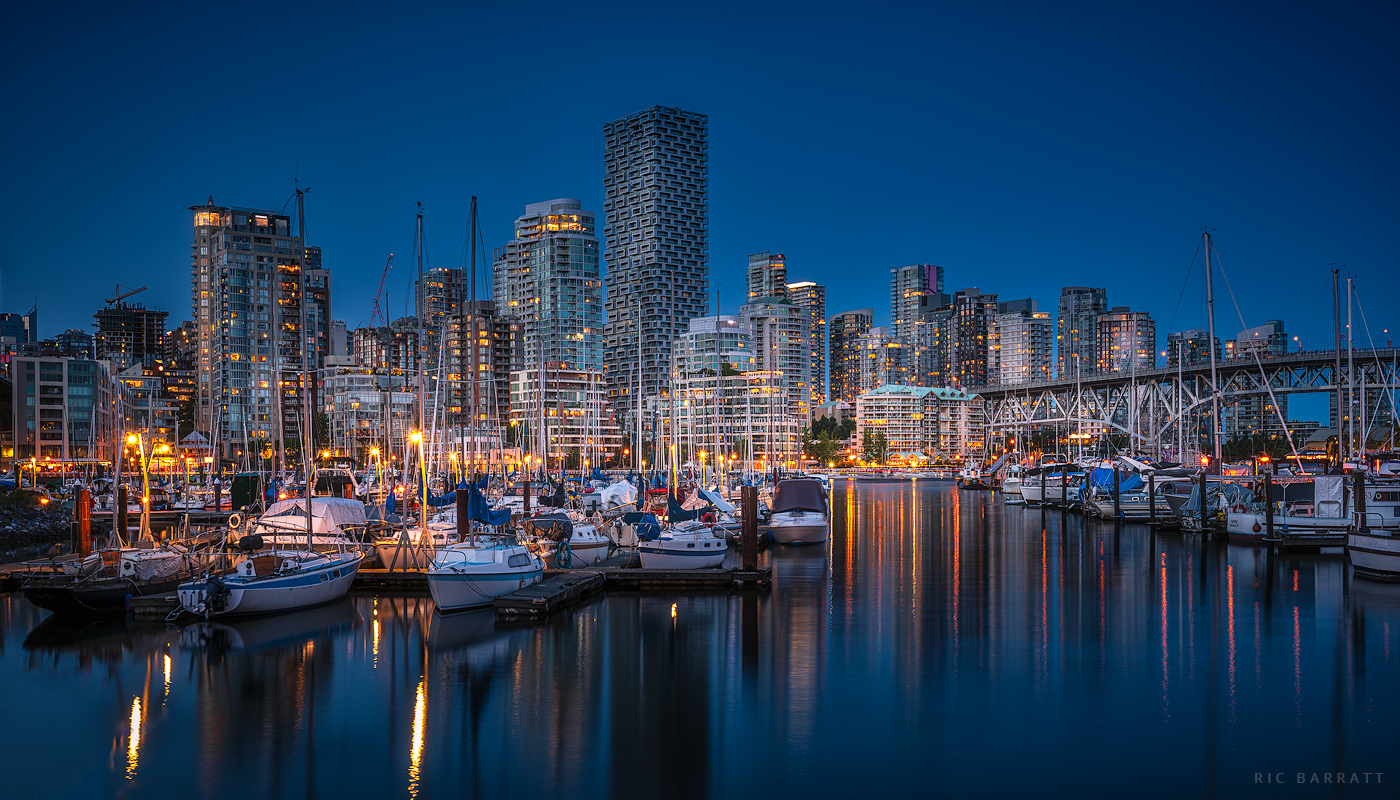 Cityscape of Downtown Vancouver's Fisherman's Wharf at dusk.